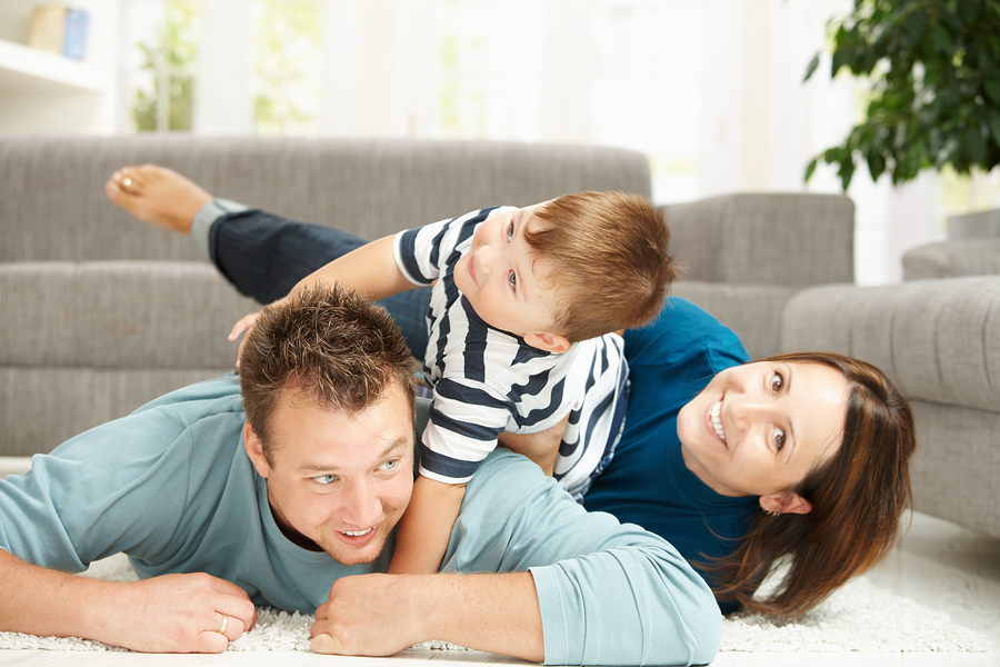 bigstock-Happy-family-playing-at-home-13096373