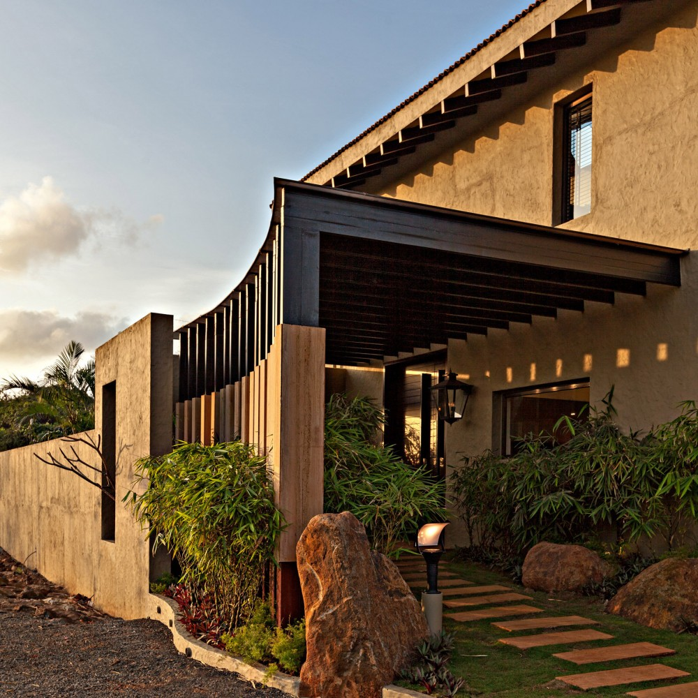 Inspiring-Exterior-Details-of-Monsoon-Retreat-Architecture-with-Wood-Cocrete-Walls-Curving-Cladding-and-Random-Walk-Path-and-Desert-Stones